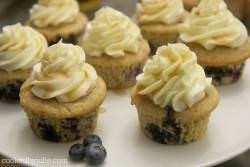 blueberry pancake cupcakes served on a white platter with fresh blueberries