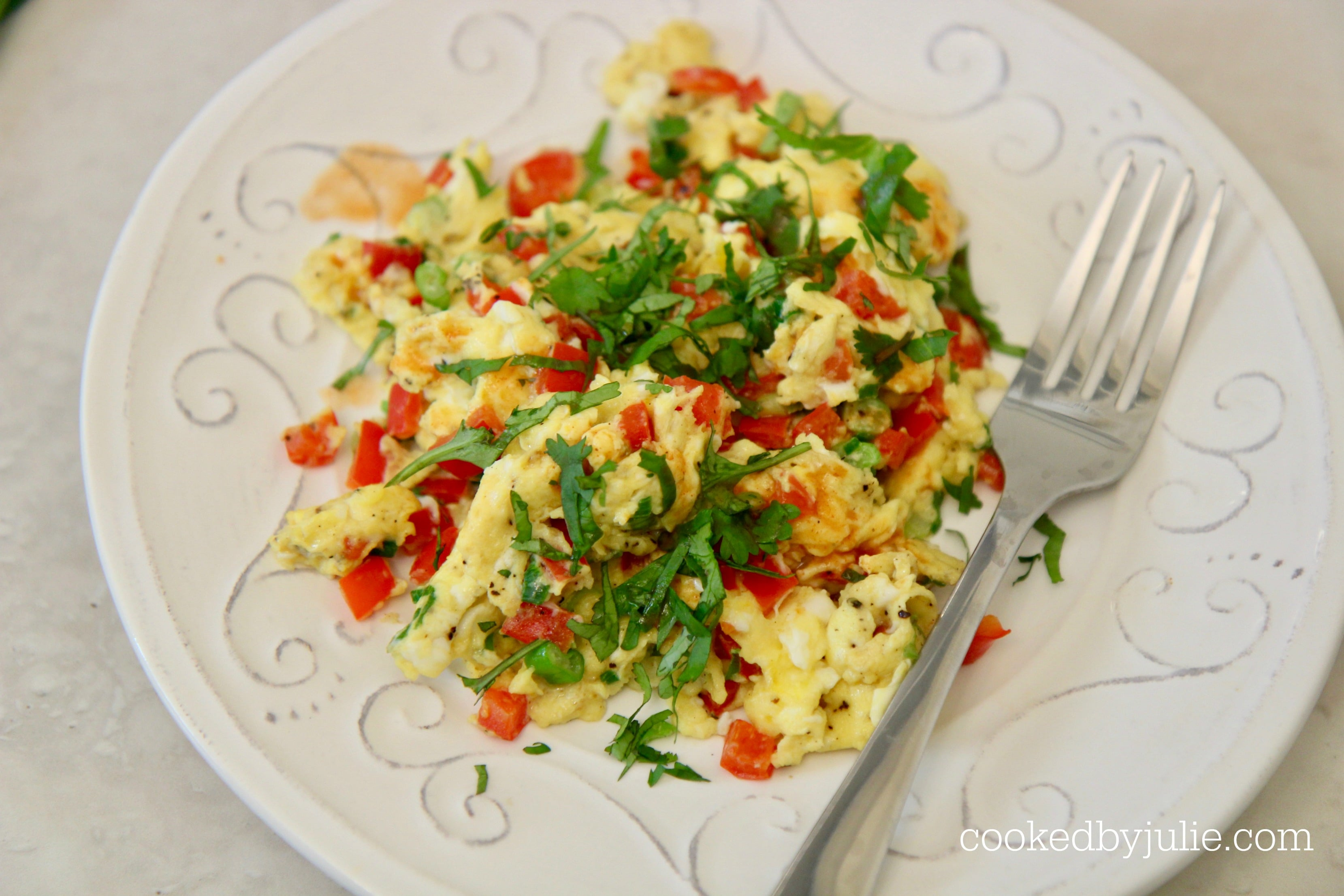 scrambled eggs with peppers and onions make the perfect easy breakfast.
