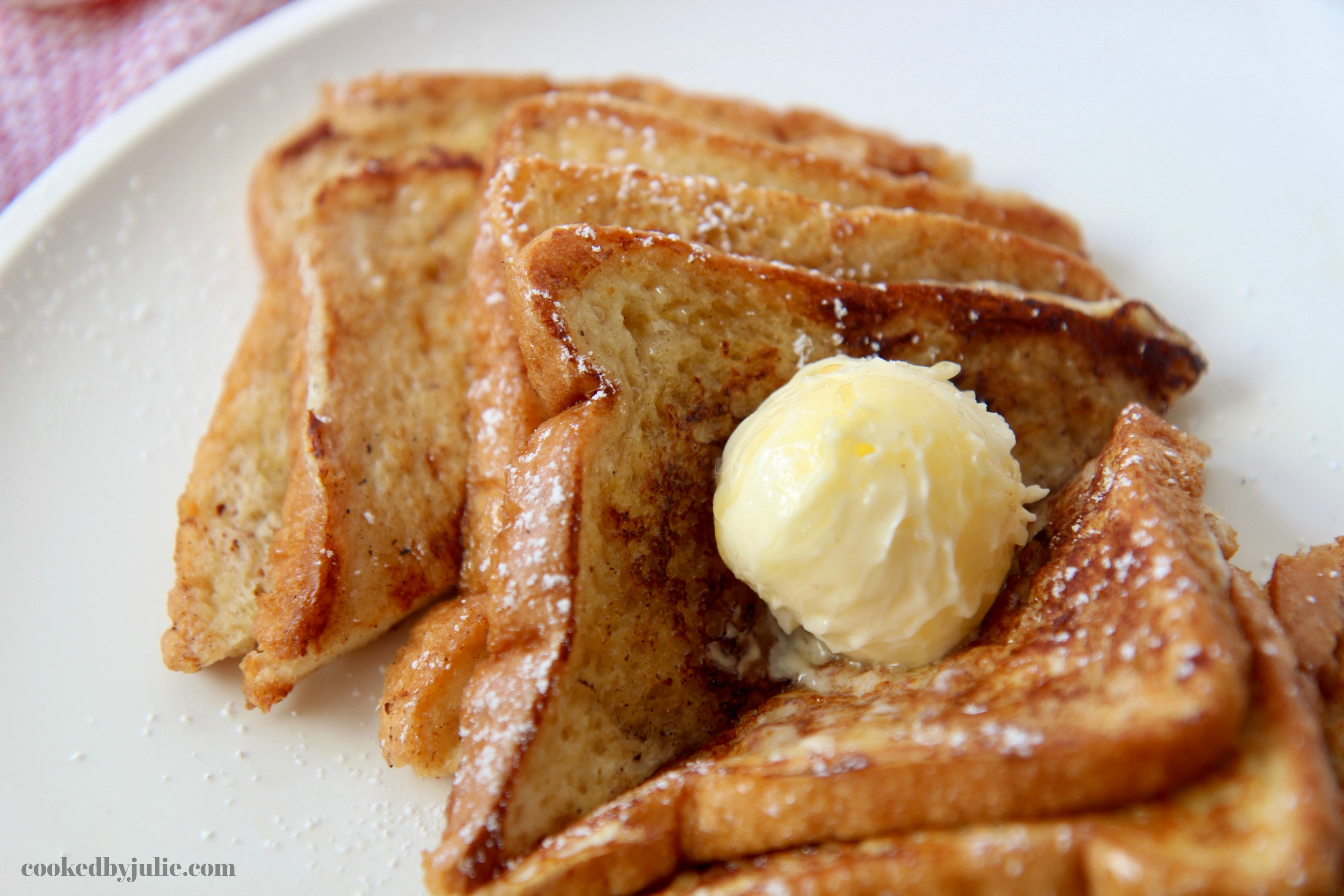Perfectly cooked French Toast with softened butter