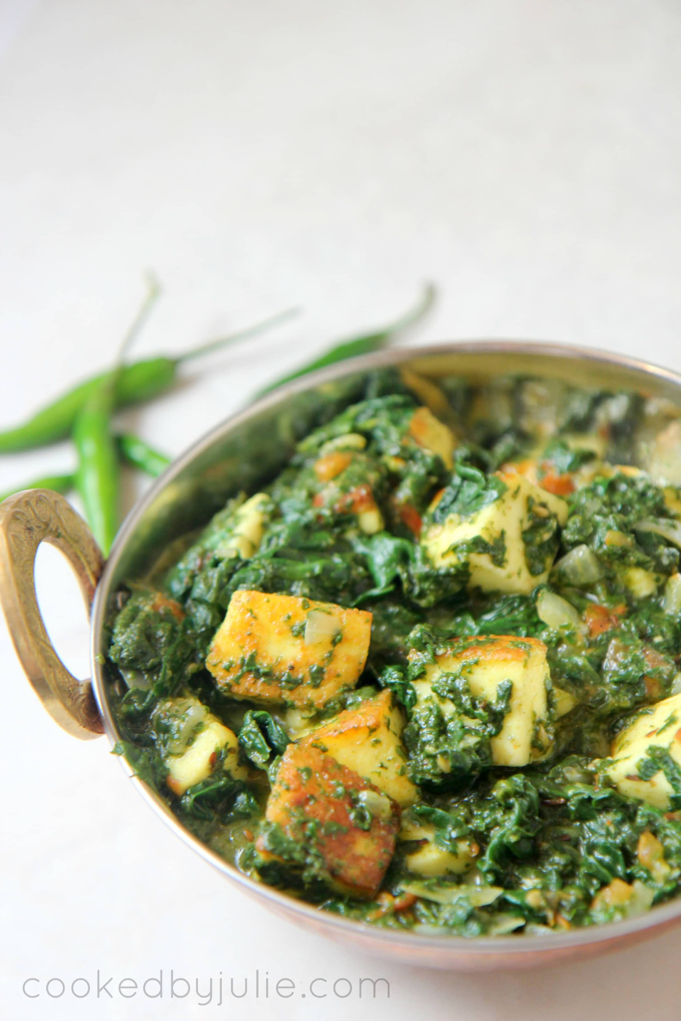 Paneer simmered with spinach and a fresh coriander gravy, seasoned to perfection for a delicious Indian dish