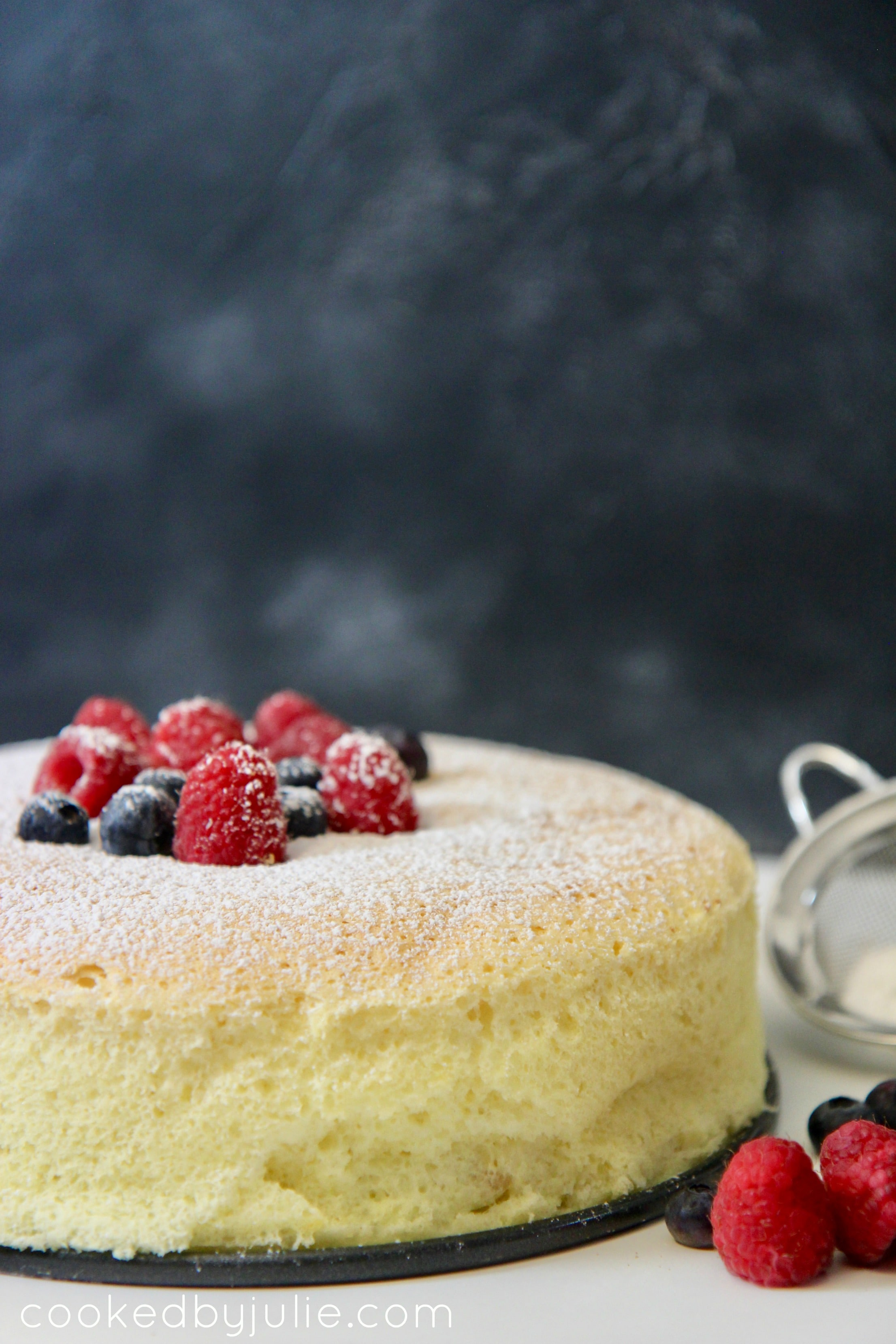 Japanese Cotton Cheesecake with fresh fruit and powdered sugar