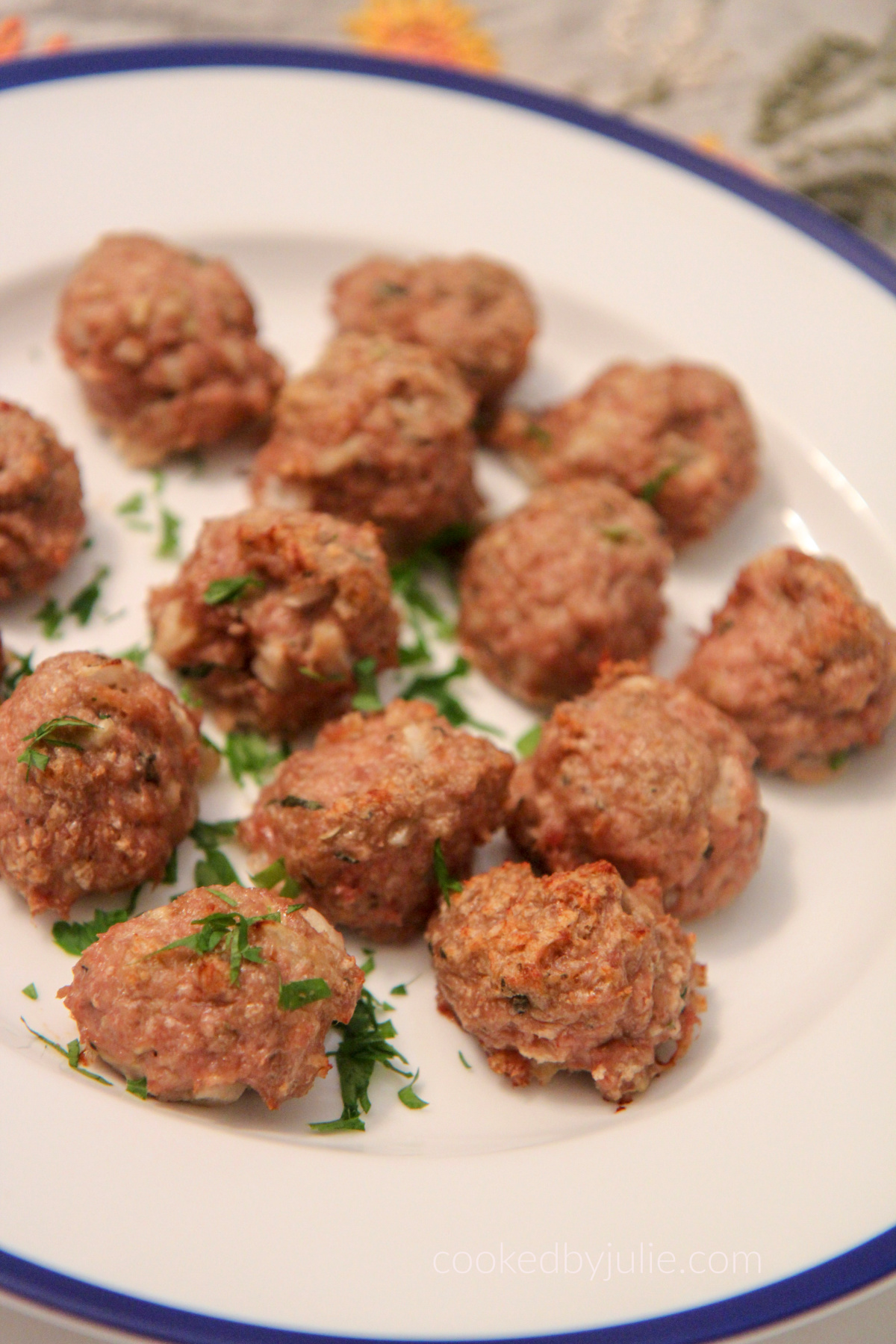 baked turkey meatballs on a white and blue plate