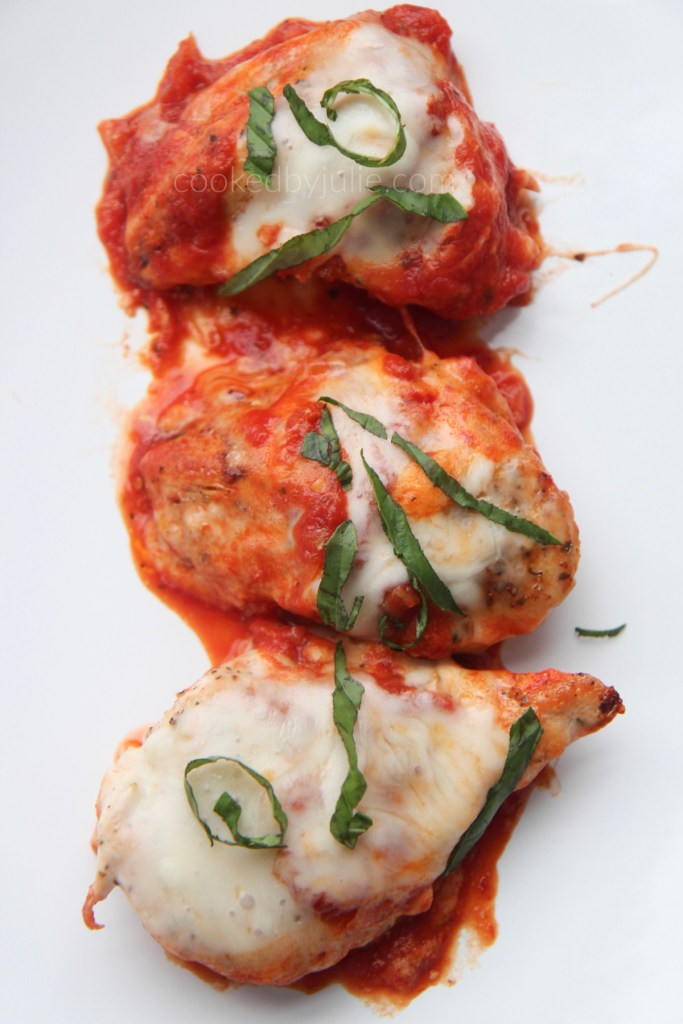 3 grilled chicken servings with sauce, cheese, and basil served on a white plate