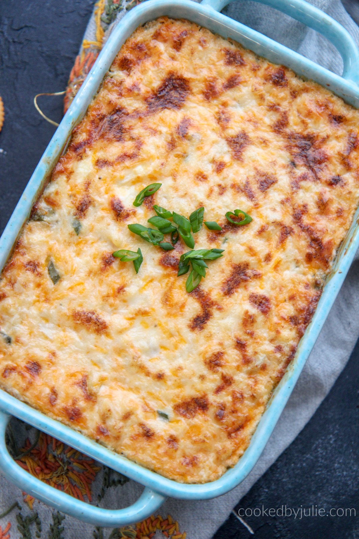 Hot crab dip in a blue baking dish