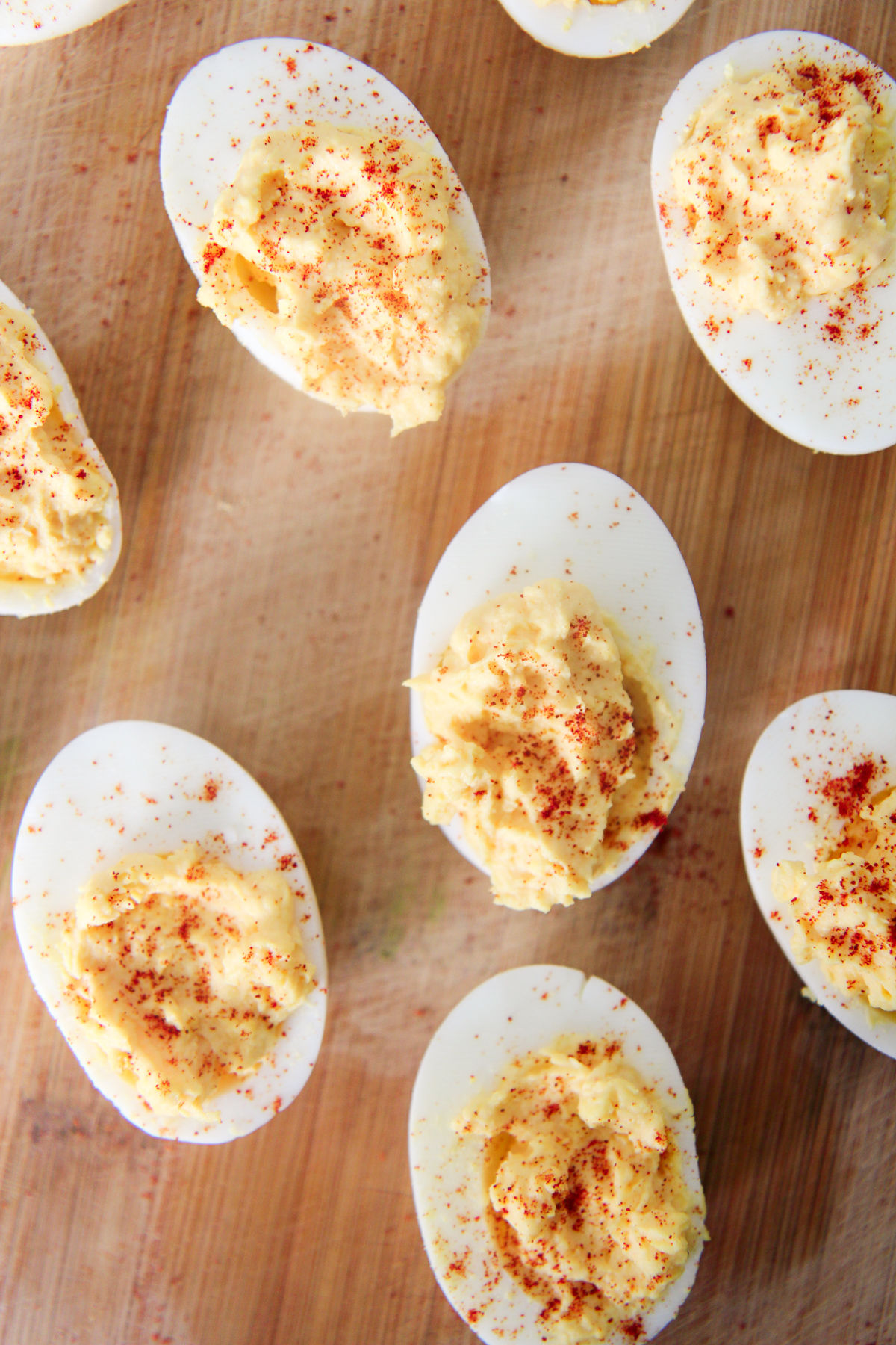 deviled eggs on a wood board