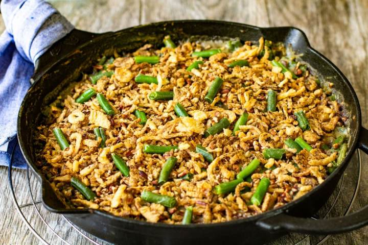 green beans and fried onions in black skillet