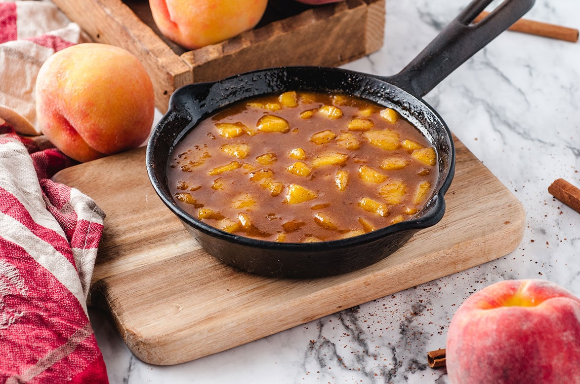peach compote in a black iron skillet