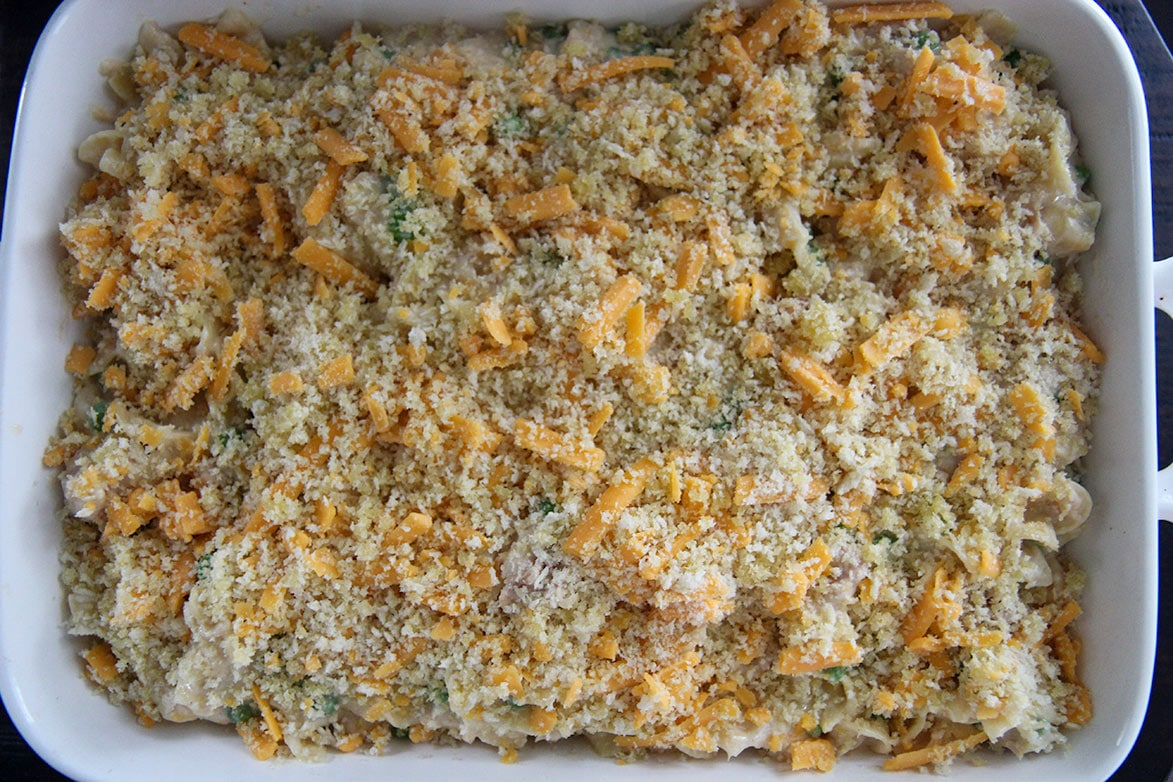 noodles with breadcrumbs and cheese in a white baking dish
