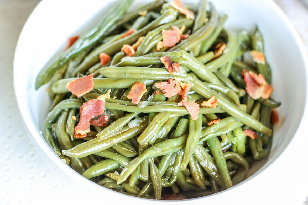small bowl of green beans with bacon up close
