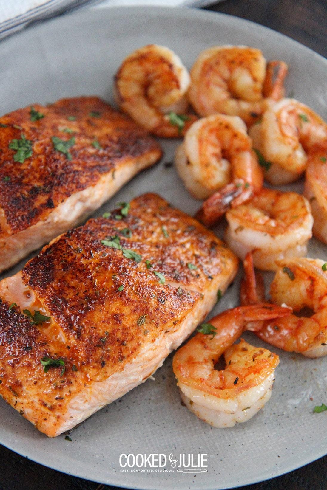 cajun salmon and shrimp on a gray plate