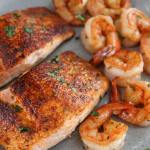 cajun salmon and shrimp on a gray plate