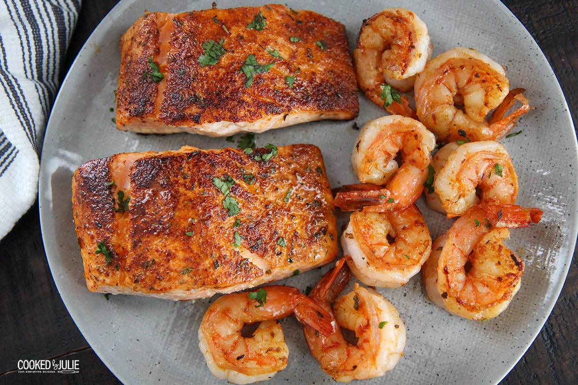 2 salmon fillets and 8 shrimp on a plate