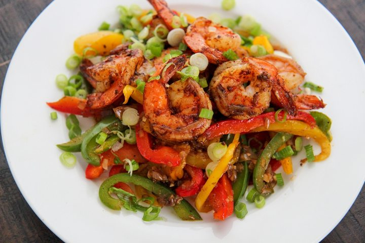 shrimp and veggies on a white plate.