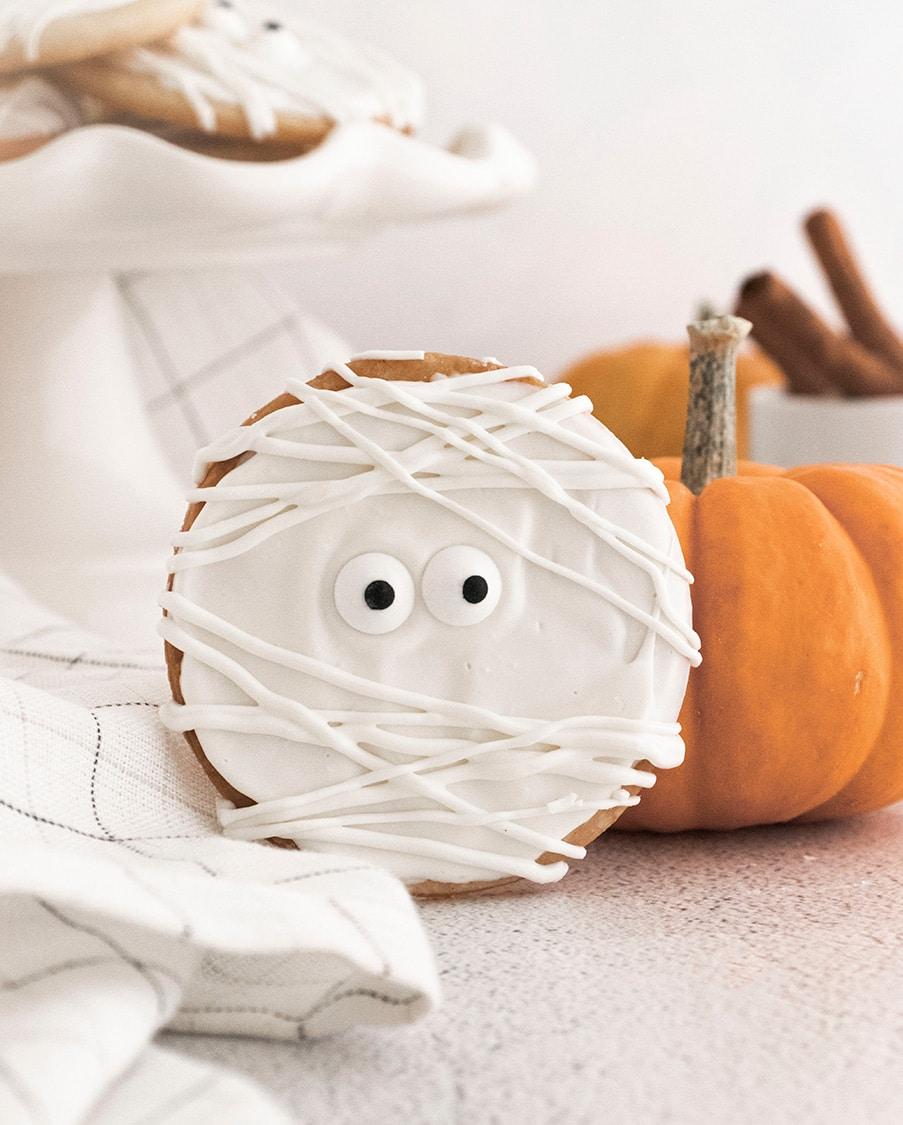 one mummy cookie and an orange pumpkin