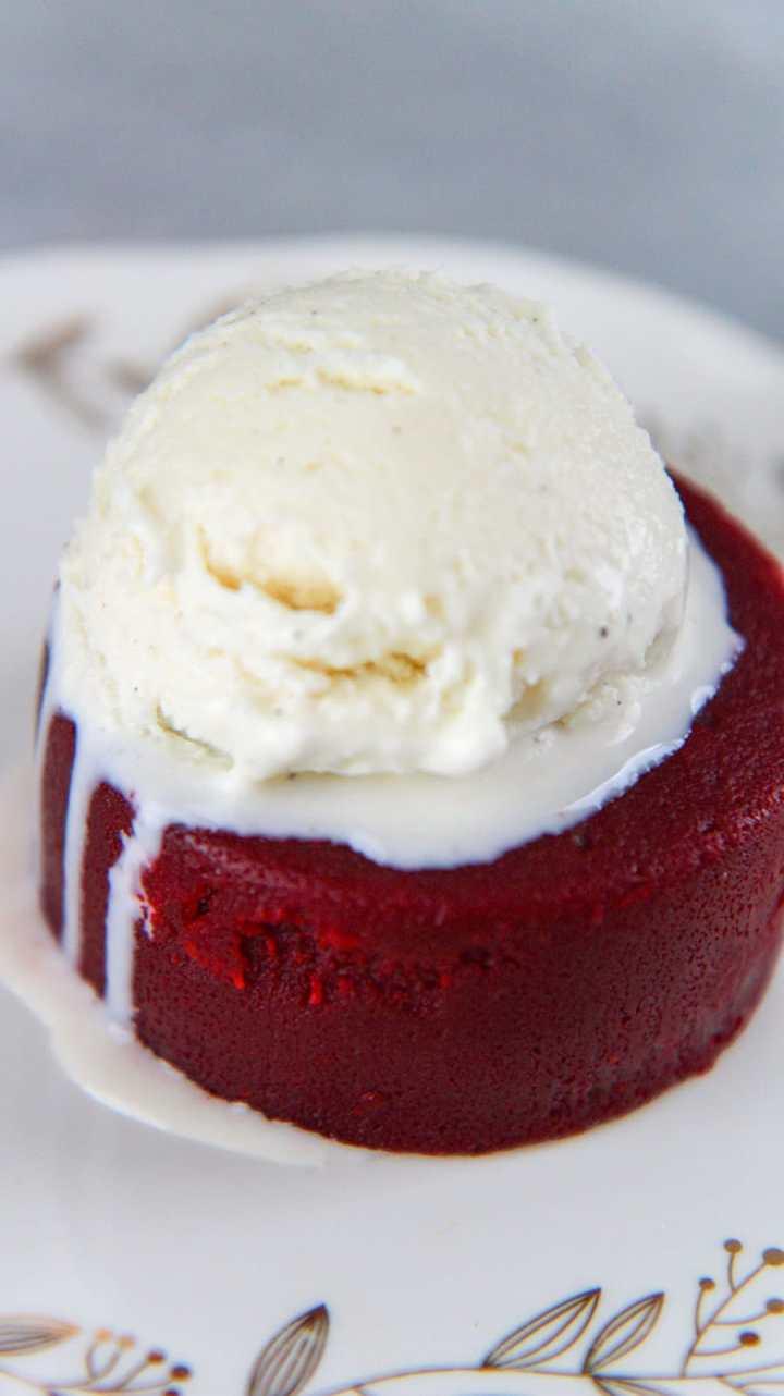 red velvet lava cake with vanilla ice cream on top.