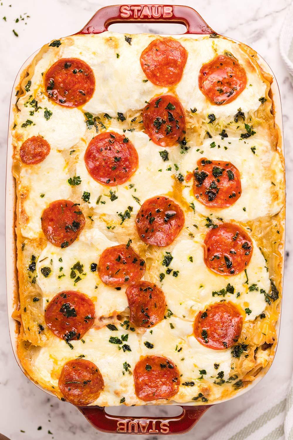 pizza lasagna in a red casserole