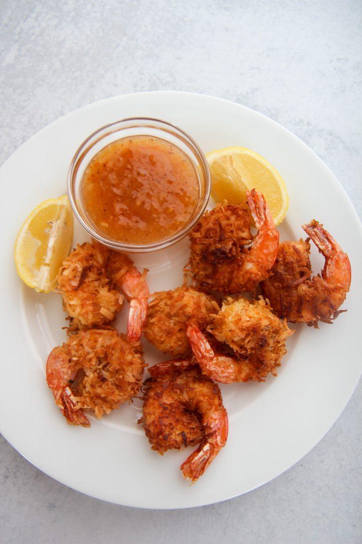 coconut shrimp on a white plate.