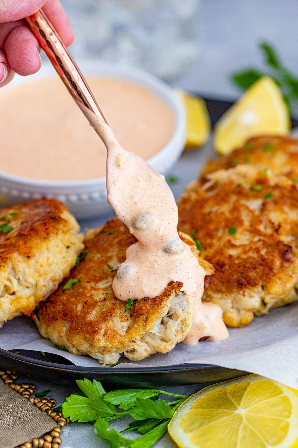 crab cakes with remoulade sauce on top