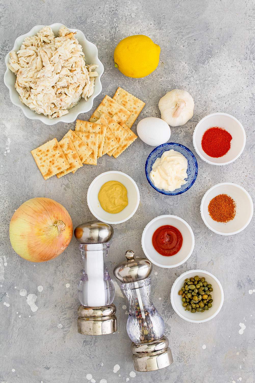 crab, mayo, lemon, salt, pepper, onion, saltine crackers, and spices.