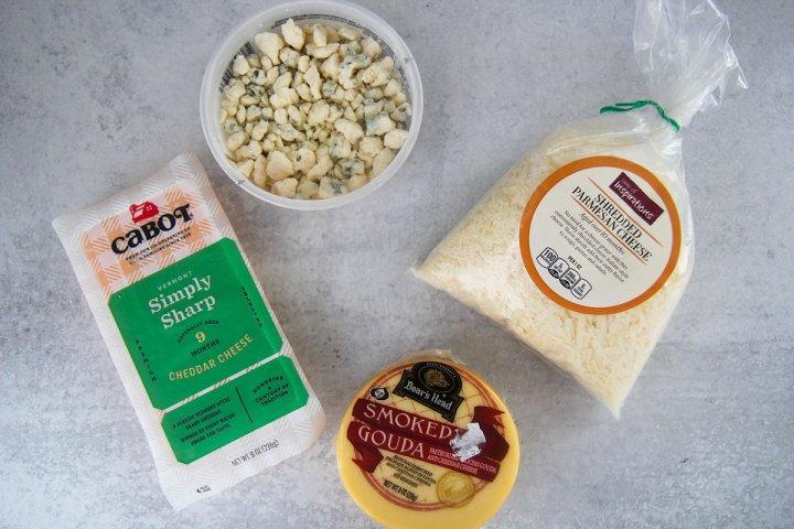 four ingredients, cheddar, gouda, parmesan, and gorgonzola.