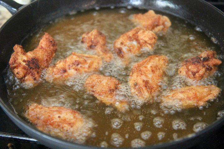chicken wings frying in oil