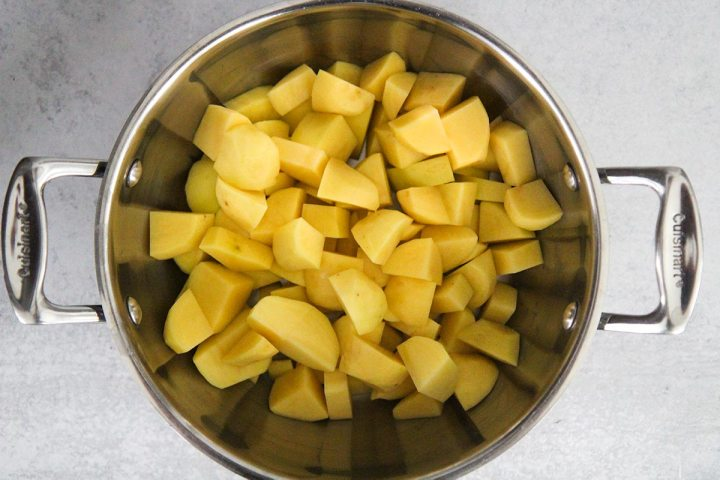 peeled and cooked potatoes in a pot.