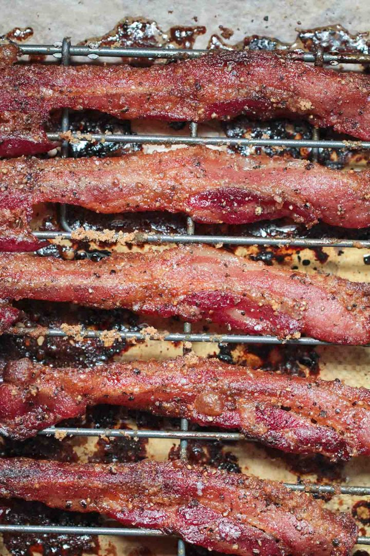 bacon strips on a wire rack.