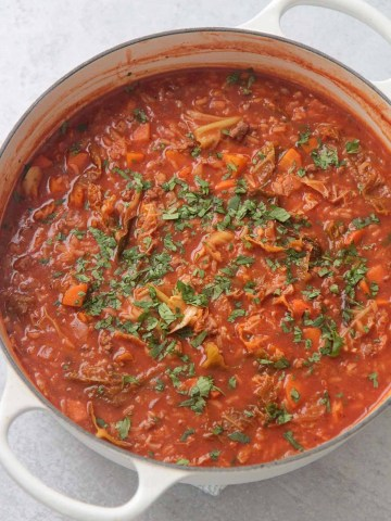 cabbage roll soup in a white pot.