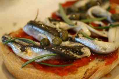 my favourite is simple - anchovies, capers, rosemary and salt and pepper - deliciousness.