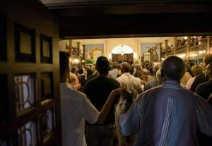 """People sing """"We Shall Overcome"""" during a service at Morris Brown AME Church June 18, 2015 in Charleston, South Carolina. US police on Thursday arrested a 21-year-old white gunman suspected of killing nine people at a prayer meeting in one of the nation's oldest black churches in Charleston, an attack being probed as a hate crime. The shooting at the Emanuel African Methodist Episcopal Church in the southeastern US city was one of the worst attacks on a place of worship in the country in recent years, and comes at a time of lingering racial tensions. AFP PHOTO/BRENDAN SMIALOWSKIBRENDAN SMIALOWSKI/AFP/Getty Images"""