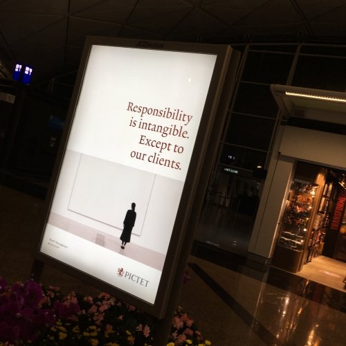 hk-hong-kong-airport-advert-banner-art-pictet-wealth-aum-private-banking
