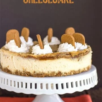 cheesecake on a cake plate with orange fabric under it