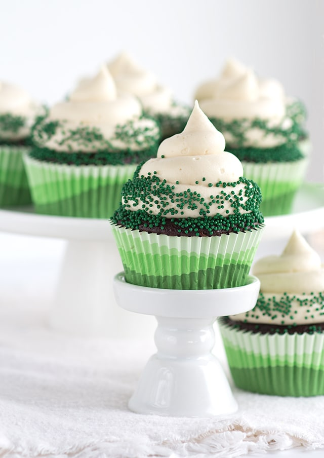 dessert plate with Chocolate Guinness Cupcakes with Baileys Cream Cheese Frosting topped with green sprinkles