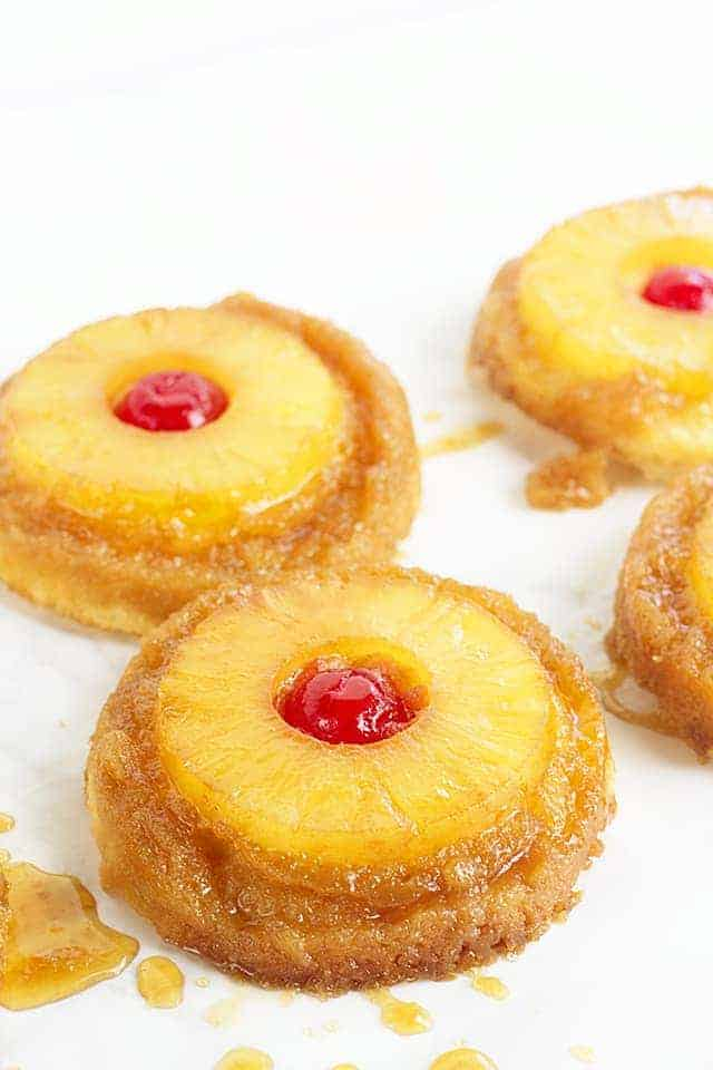 pineapple upside down sugar cookies on a white table with brown sugar