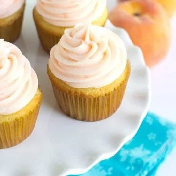 Yellow Cupcakes with Peach Cream Cheese Frosting - Light and fluffy homemade yellow cupcakes topped with a peach flavored cream cheese frosting! Perfect for all occasions!