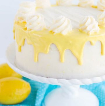 cake on white cake plate with yellow drizzle