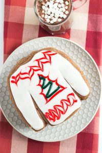 decorated hot cocoa cookies with red linen