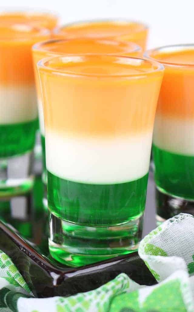 Close up photo of the St. Patrick's Day Jello Shots on a black plate.