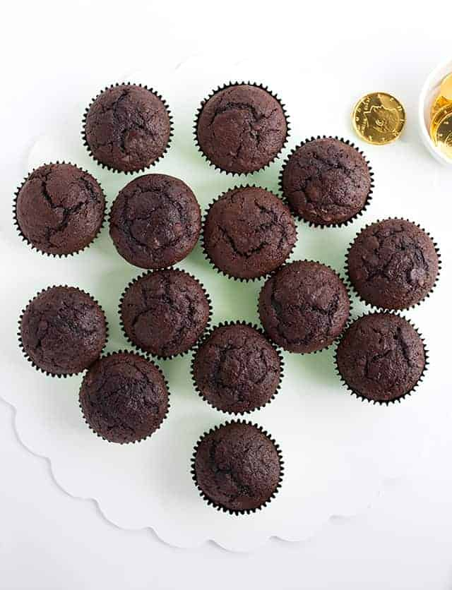 Unfrosted chocolate cupcakes laid out for the shamrock cupcake cake.
