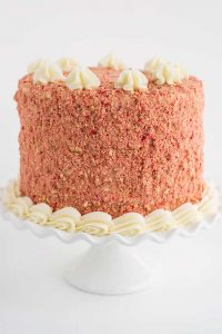 All of the strawberry shortcake cake in the photo included white ruffled cake plate.