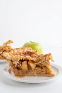 the side of a piece of apple pie with cheddar cheese crust