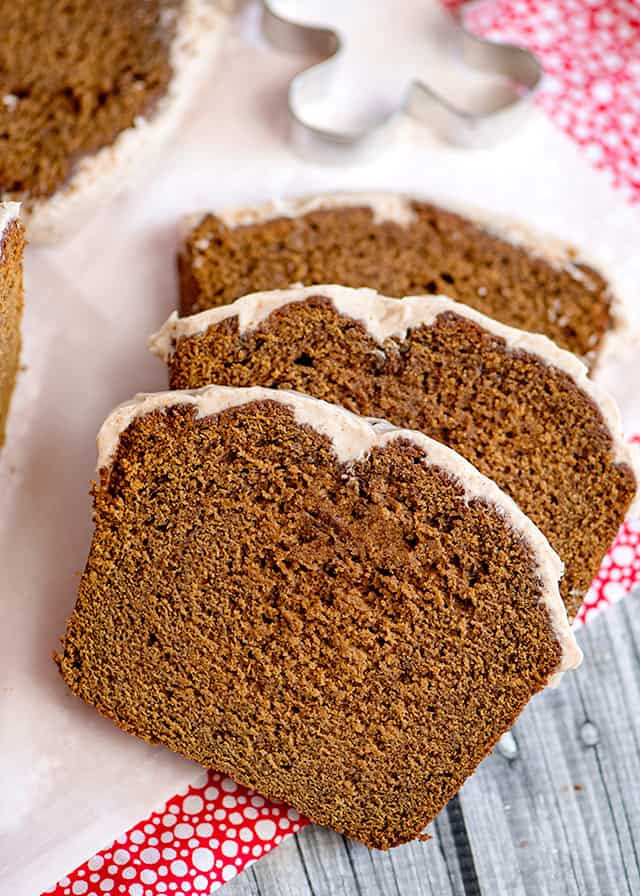 three slices of gingerbread loaf on parchment paper and pink fabric