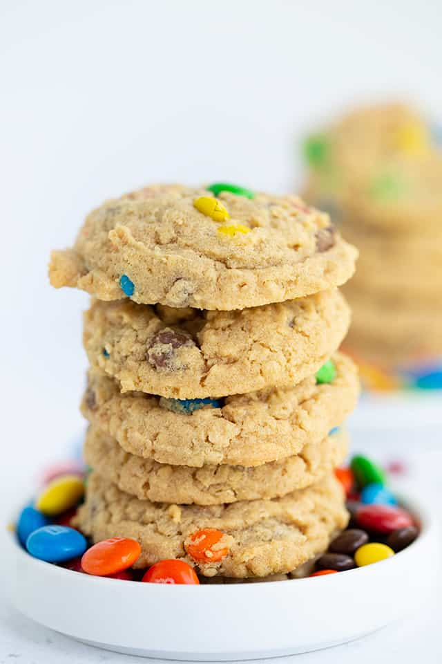 monster cookies stacked in a small white plate