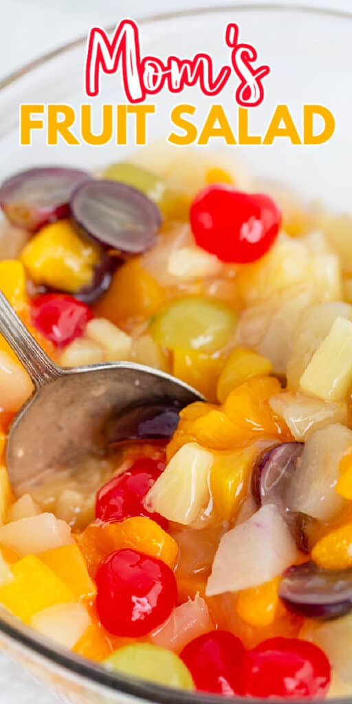 zoomed in image of fruit salad in a bowl with a serving spoon and the recipe name at the top
