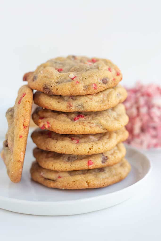 stack of cookies with a cookie propped against the stack on a white plate