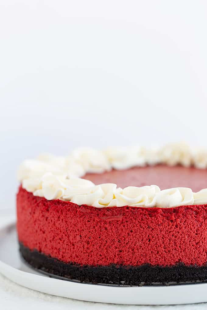 red velvet cheesecake on a white plate on a white background