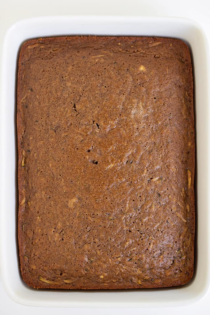 overhead image of the whole cake in a white pan on a white surface