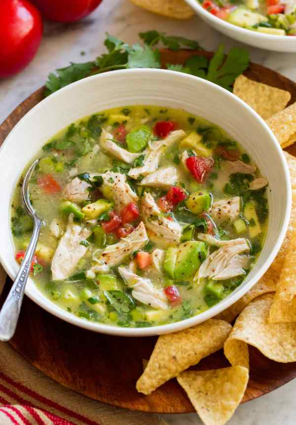 Single serving of chicken and avocado soup in a side-facing bowl.