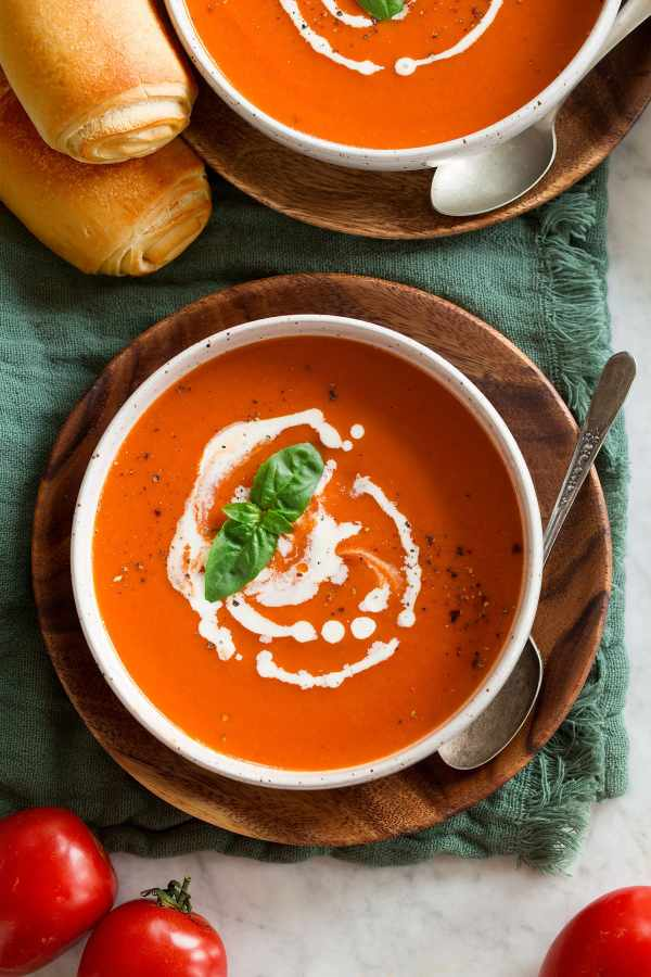 Overhead shot of serving the tomato soup swirled with cream.