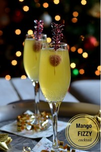 Mango Fizzy Cocktail - A tropical flavored cocktail with mango vodka and sparkling cider to serve for your New Years Party!